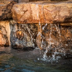 traditions pools & landscape bryan college station texas - pool project with rock waterfall