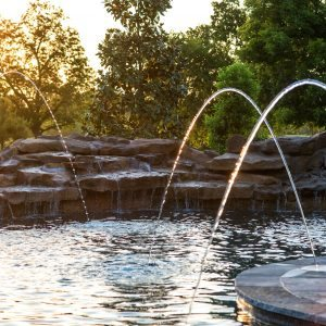 traditions pools & landscape bryan college station texas - pool project with fountains, rock accents & waterfall