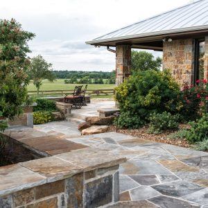 traditions pools & landscape bryan college station texas - in-ground swimming pool construction with rock walkway