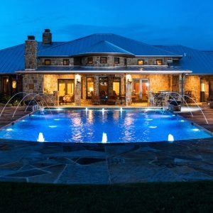traditions pools & landscape bryan college station texas - beautiful in-ground swimming pool construction with fountains & elegant lighting