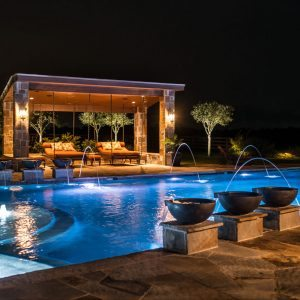 traditions pools & landscape bryan college station texas - beautiful in-ground swimming pool construction with fountains & elegant lighting 4