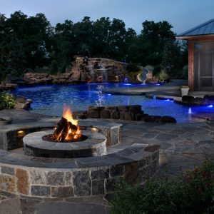 traditions pools & landscape bryan college station texas - beautiful in-ground swimming pool construction with rock firepit