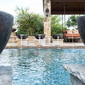 traditions pools & landscape bryan college station texas - swimming pool construction with arbour, patio & fountains
