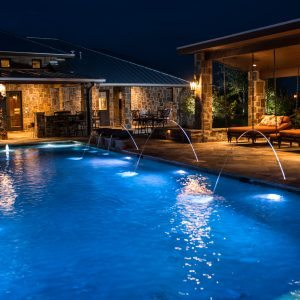 traditions pools & landscape bryan college station texas - elegant pool lighting with fountains