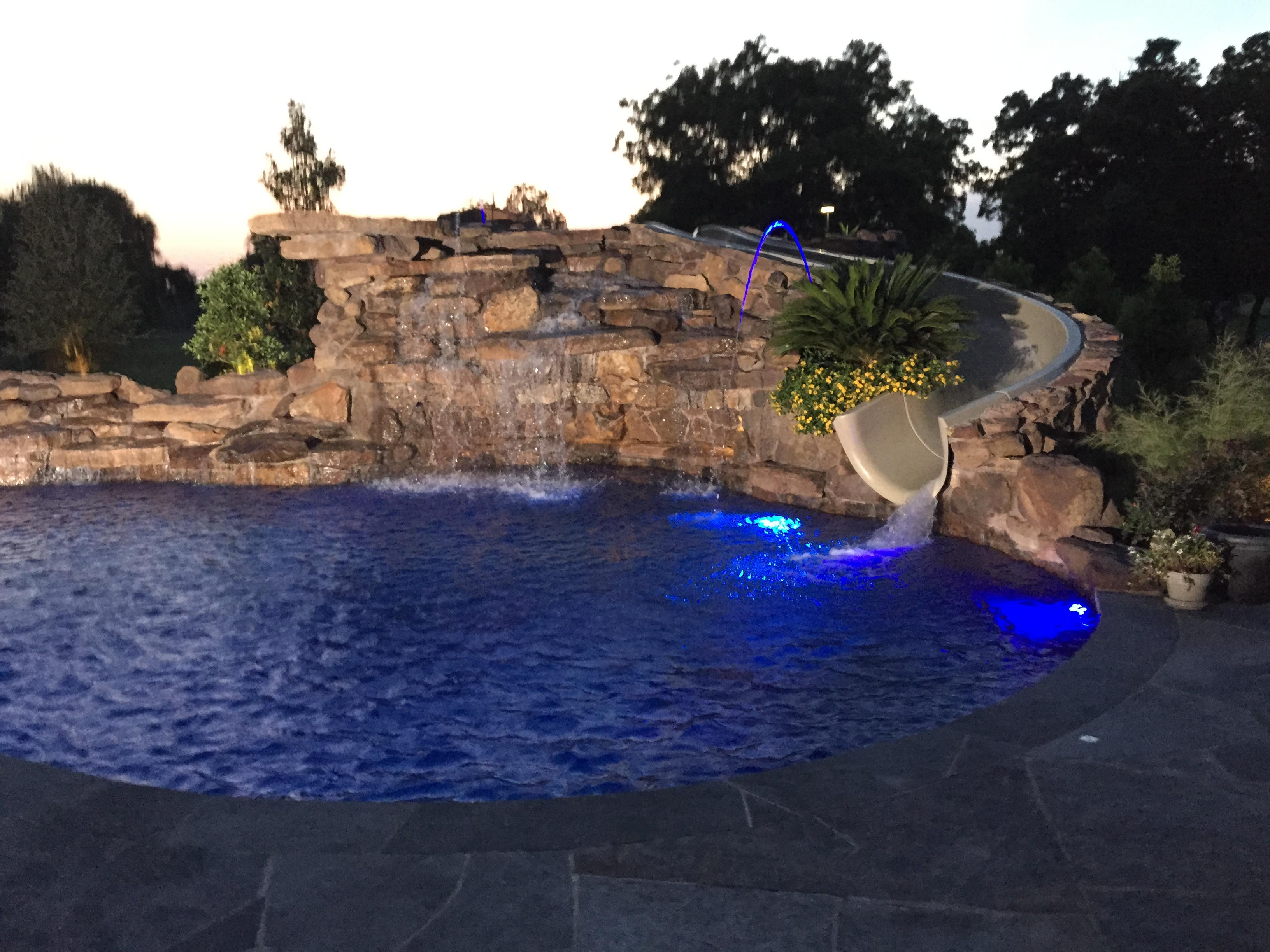 traditions pools & landscape bryan college station texas - pool project with rock & waterslide