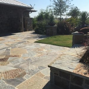 traditions pools & landscape bryan college station texas - rock patio walkway design & construction 2