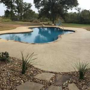traditions pools & landscape bryan college station texas - custom swimming pool construction & sidewalk construction
