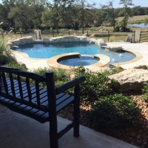 traditions pools & landscape bryan college station texas - custom swimming pool construction with jacuzzi, sidewalks & landscaping