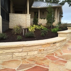 traditions pools & landscape bryan college station texas - rock walkway & ledge construction
