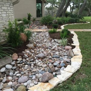 traditions pools & landscape bryan college station texas - rock walkway & ledge construction 4