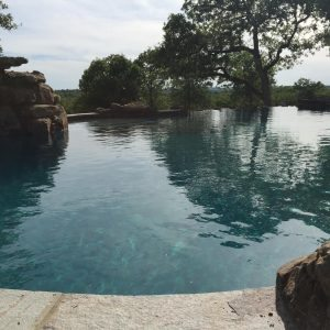 traditions pools & landscape bryan college station texas - pool design, construction rock work