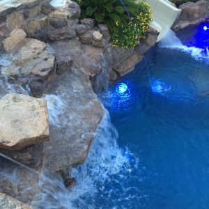 traditions pools & landscape bryan college station texas - pool project with rock, waterslide, waterfountain & landscaping