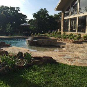 traditions pools & landscape bryan college station texas - custom swimming pool & patio construction & landscaping design