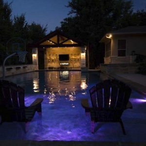 traditions pools & landscape bryan college station texas - swimming pool & jacuzzi construction with elegant lighting