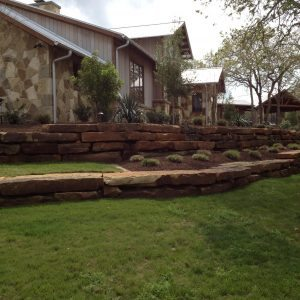 traditions pools & landscape bryan college station texas - custom landscaping design, flowerbeds & decorative rock retaining walls
