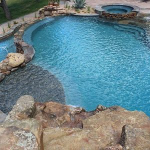 traditions pools & landscape bryan college station texas - pool project with rock & landscaping